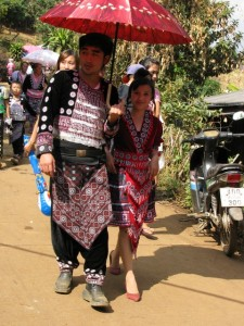 H'mong couple with sunshade